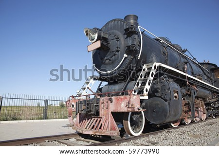 The old locomotive train running outside - stock photo