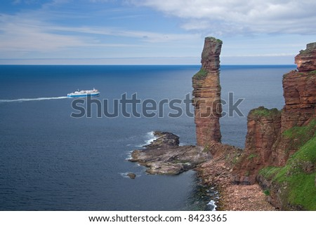 The Old Man of Hoy and a car ferry, Orkney - stock photo