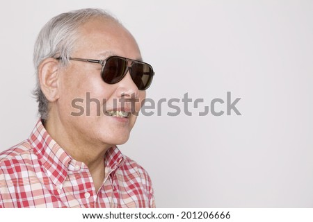 The old man wearing sunglasses