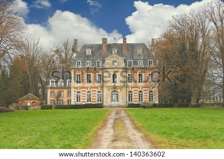 The old mansion in the park. France - stock photo