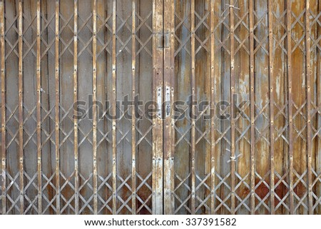 the old metallic door lock - stock photo