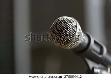 The old microphone on selected focus in blurred background.