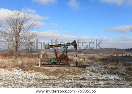 The old oil Field pump jack. USA, Ohio - stock photo