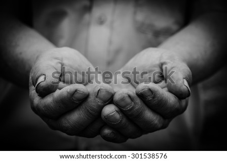 The old open hands with dark corners. - stock photo