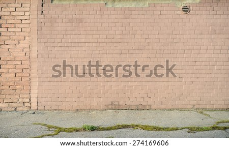 The old painted brick wall and asphalt floor.