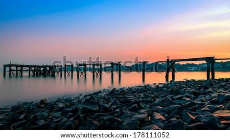 The Old Pier at Sunset, Aberdour, Scotland - stock photo