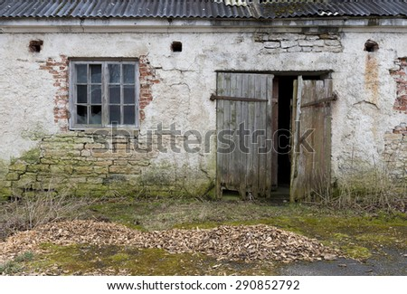 The old plastered limestone wall with a windows and a door as background