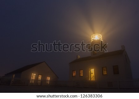The Old Point Loma Lighthouse in the fog at night
