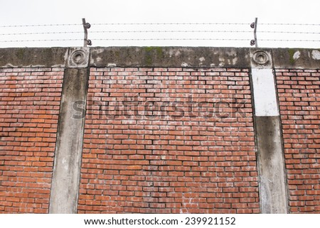 The old red brick prison walls - stock photo