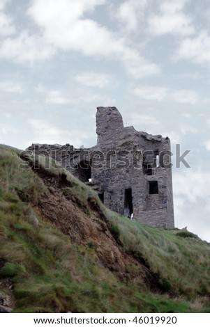 the old ruin of a castle in ballybunion - stock photo