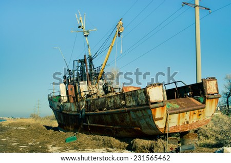 The old rusty ship, on a dump - stock photo