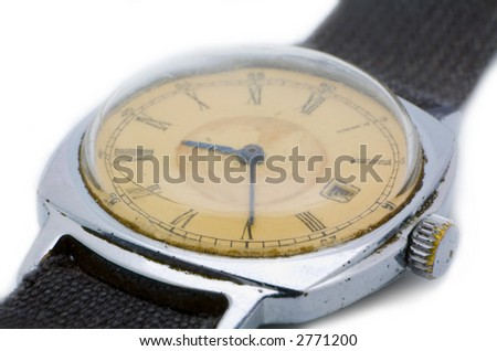 the old scratched watch isolated on white background