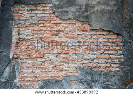 The old shabby concrete and brick cracks. Separate elements wall