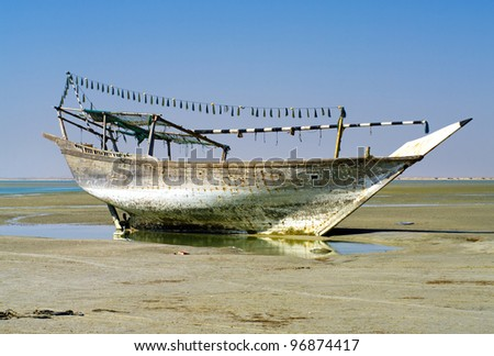 The old ship in the dried up sea , Oman - stock photo