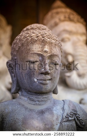 The old stone Buddha statue. Indonesia, Bali.