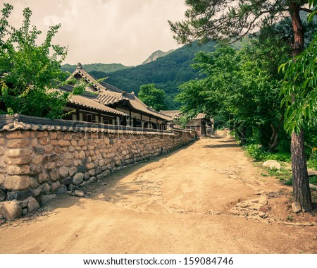 The old-style houses of a folk village in Asia. - stock photo