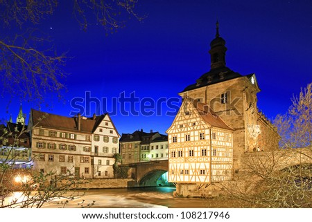 The Old Town Hall of Bamberg, Bavaria, Germany on a very small island in the river Regnitz at night - stock photo