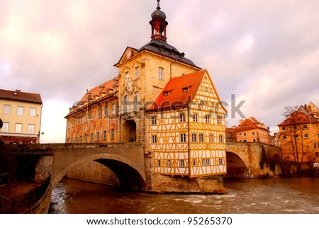The Old Town Hall (1386) of Bamberg(Germany) was built in the middle of the Regnitz river, accessible by two bridges . The Old Town of Bamberg is listed as a UNESCO World Heritage. - stock photo