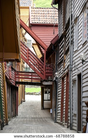 The old town of Bergen, a narrow street between wooden houses - stock photo