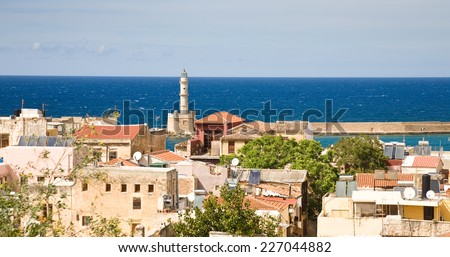 The old town of Chania with famous lighthouse in Crete, Greece - stock photo