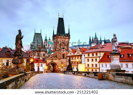 The Old Town with Charles bridge in Prague early in the morning - stock photo