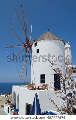The old traditional windmill, one of the most recognizable buildings in the town of Oia, Santorini, Greece