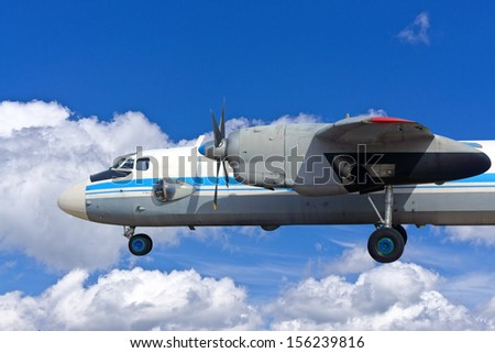 the old turboprop airplane on sky background - stock photo