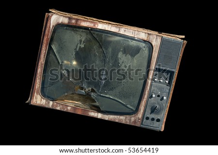 The old TV with a broken screen - stock photo