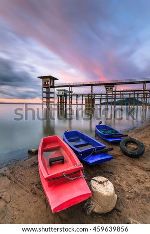 The old water supply station and colorful boats. - stock photo
