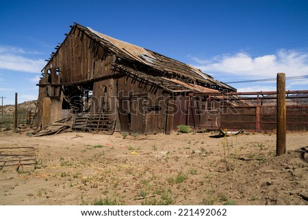 The old wooden barn in the country. - stock photo