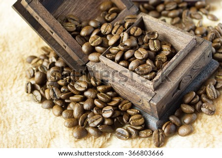 The old wooden box with roasted coffee beans