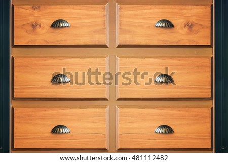 The old wooden drawer with metal handle