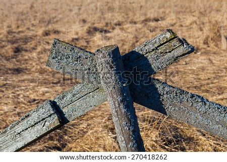 The old wooden fence in a field, Estonia.  - stock photo