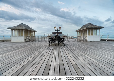 The old wooden pier at Cromer on the north coast of Norfolk - stock photo