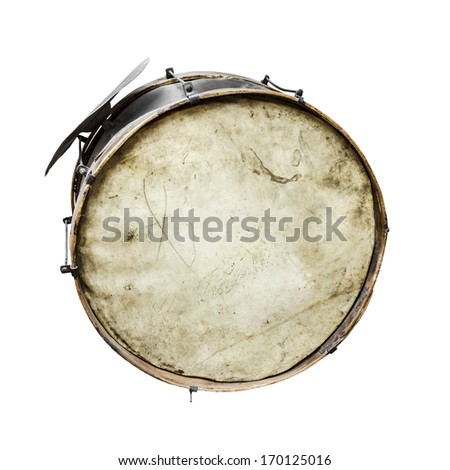 The old, worldly-wise, shabby, dusty bass drum for a wind band and a beater - stock photo
