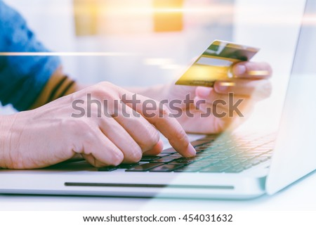 The online shopping card and holding credit card with hand for payment online shopping, this lifestyle new generation of people on the world for decorate/design business content or finance content. - stock photo