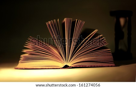 The open book on a black background