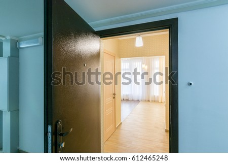 https://thumb9.shutterstock.com/display_pic_with_logo/2100203/612465248/stock-photo-the-open-front-door-in-renovated-apartment-in-new-building-612465248.jpg