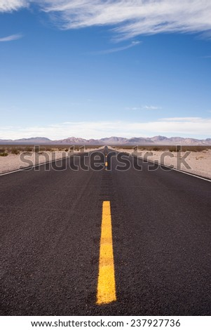 The open road heading west out of Death Valley NP - stock photo