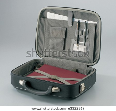 the opened black briefcase isolated on plain background