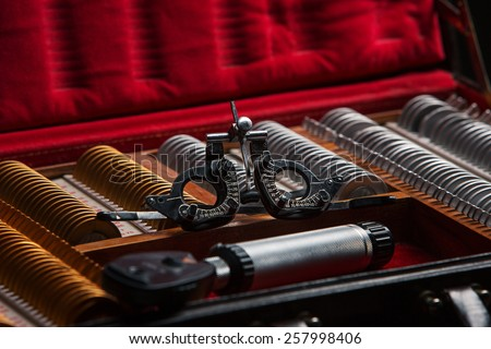 The ophthalmologist box with lenses - set for optometric research ophthalmologist  - stock photo
