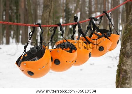 The orange helmets - climbing equipment - stock photo