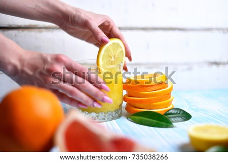 The orange in the hands
