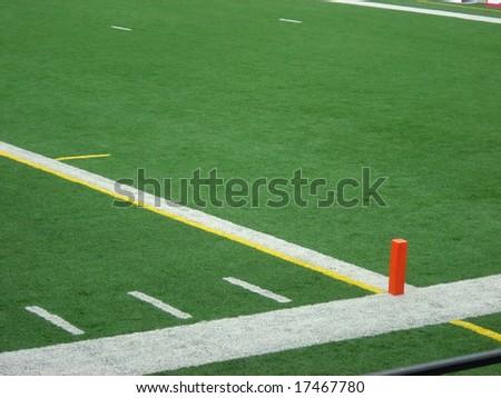 The orange pylon marking the endzone line. - stock photo
