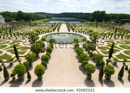 The Orangerie garden of Versailles Palace, Paris, France. And in the far distance have a lake that is the Pond of the Swiss. - stock photo