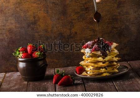 The original Belgian waffles with strawberries, chocolate and sprinkled with sugar