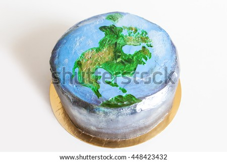 The original hand painted cake with a picture of North American continent, the planet Earth