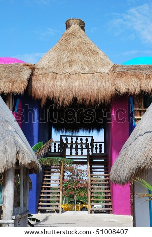 The original resort building with a straw roof in Mahahual (Mexico).