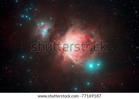 The Orion Nebula (also known as Messier 42, M42, or NGC 1976) is a diffuse nebula situated south of Orion's Belt. - stock photo