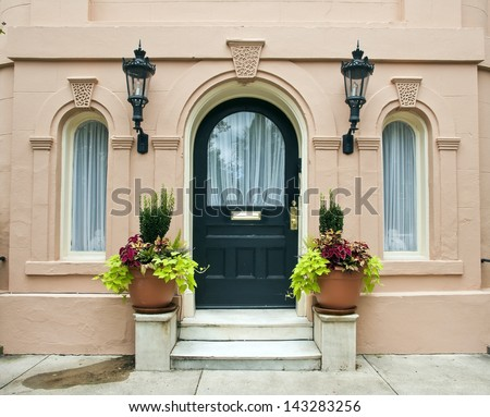 The ornate features of an entrance to a historical pink house, built in the late seventeen hundreds, in Charleston, South Carolina. - stock photo